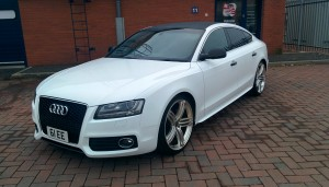 Audi A5 TDI 5dr wrapped in Pure Gloss White with Carbon Fibre Roof and Gloss Black Mirrors and Handles