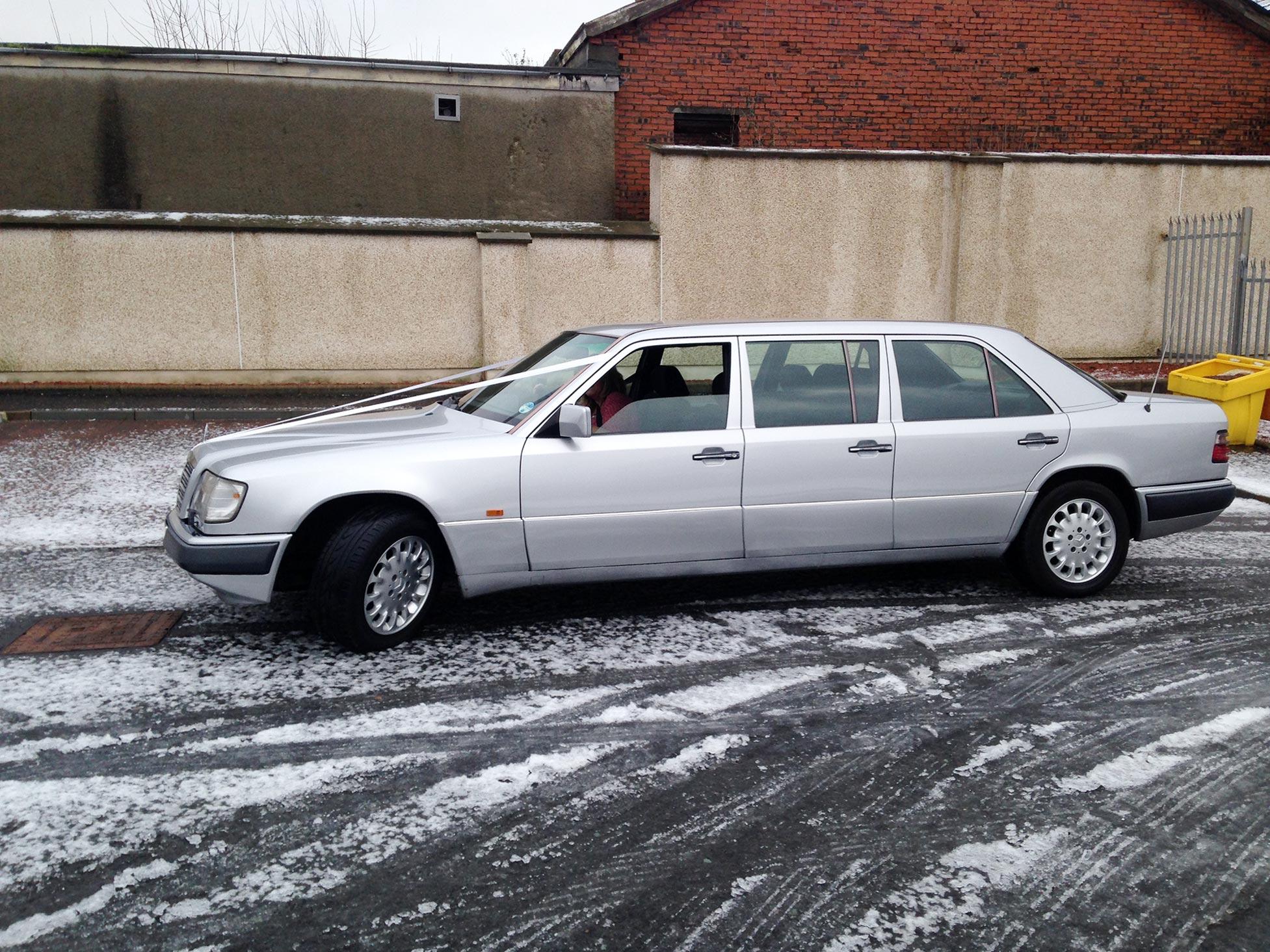 Sterling Silver Vinyl Wrap On 6 Door Mercedes-Benz Limousine