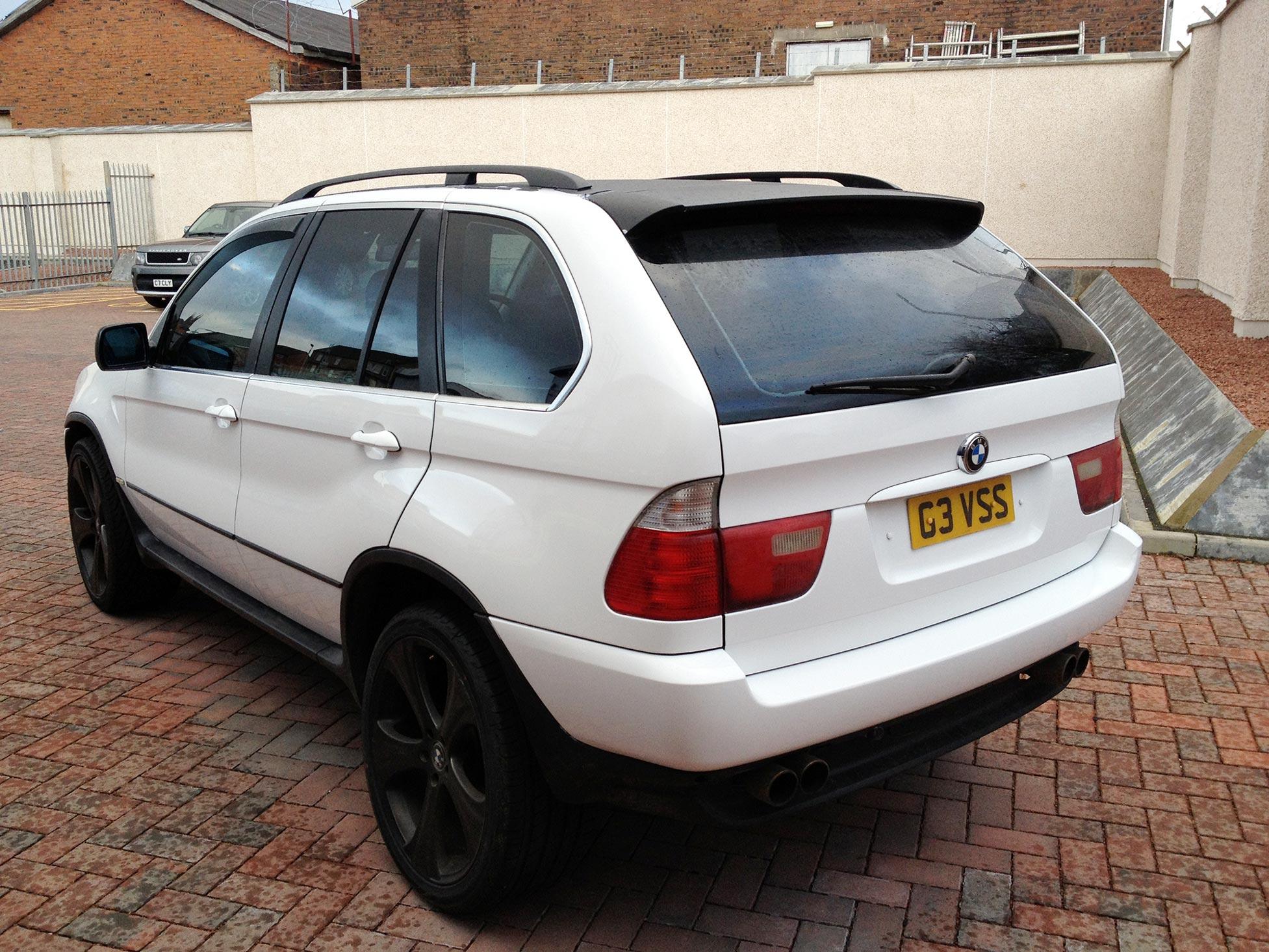 Gloss White Vinyl Wrap On BMW X5